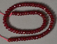 Ruby colored jade faceted rondelle beads.