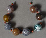 Multi color American agate round beads.