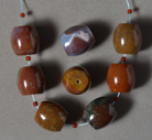 Several large barrel beads from American multi color agate.