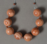 Several large red banded jasper round beads.