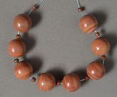 Banded red jasper round beads.
