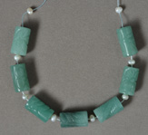 Several carved aventurine drum beads.
