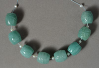 Several wide barrel beads from green aventurine.