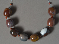Large barrel beads from multi color agate.