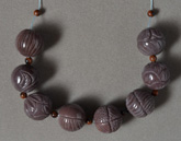 Carved round beads from sunset agate.