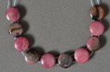 Double drilled rhodonite coin beads.