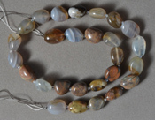 Mexican agate tumbled nugget bead strand.