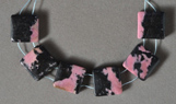 Black and pink rhodonite square beads.