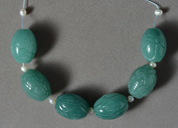 Six large carved aventurine barrel beads.