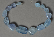 Light blue fluorite tumbled nugget beads.