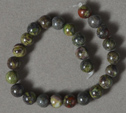 Short strand of 6mm bloodstone round beads.