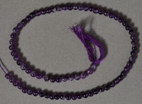 Strand of 5mm amethyst round beads.