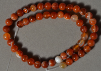 Red agate 8mm round beads.