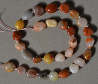 Strand of tumbled agate nugget beads.