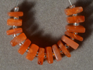 Small carnelian carved square beads.