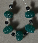 Carved and faceted onyx beads.