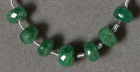 Tsavorite garnet faceted rondelle beads.