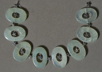 Green jade O shaped beads.