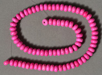 Dyed fuschia colored turquoise rondelle beads.