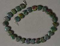 Heart shaped carved ruby zoisite beads.
