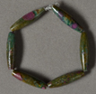 Ruby zoisite long barrel beads.