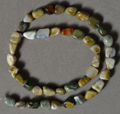 Multi color ocean jasper nugget beads.