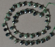Faceted drop beads from green kambaba jasper.
