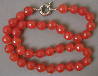 Ruby faceted round beads