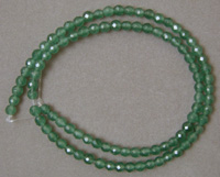 Emerald faceted round beads