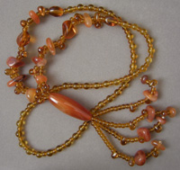 Necklace with amber colored glass and agate beads.