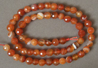 Faceted round beads from carnelian agate.