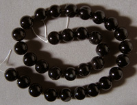 Large round beads from smoky agate.