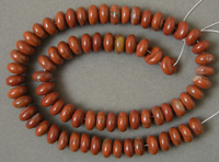Dark red colored jasper rondelle beads.