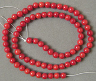 Strand of 5mm red coral round beads.