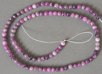 Small round beads from faux sugilite.