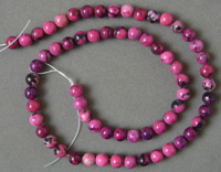 Dyed rhodonite round beads.
