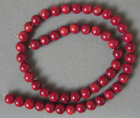 8mm round beads from dark red coral.