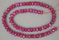 Strand of purple agate rondelle beads.