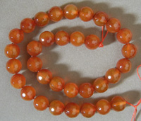 Faceted round beads from red agate.