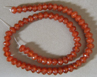 Faceted rondelle beads from red agate.
