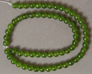 Smaller round beads from green jade.