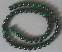 Round beads from dark green quartzite.