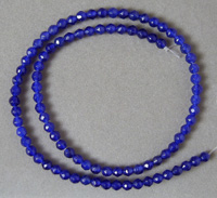 Faceted round beads from dark blue sapphire.