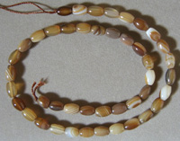 Barrel beads from brown and white striated agate.