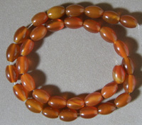 Oak barrel beads from red agate.