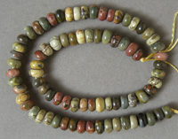 Rondelle beads from multi colored Picasso jasper.