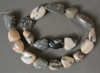 Nugget beads from zebra jasper with red.