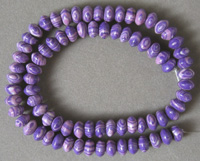 Man made gemstone rondelle beads with purple stripes.