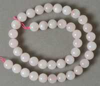 10mm round beads from light colored rose quartz.