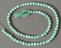 Round beads from seafoam green opal.